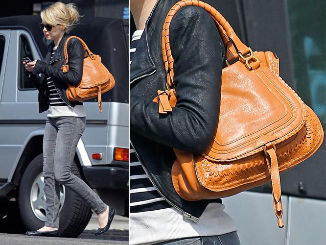 Emma Stone escolheu uma bolsa do modelo