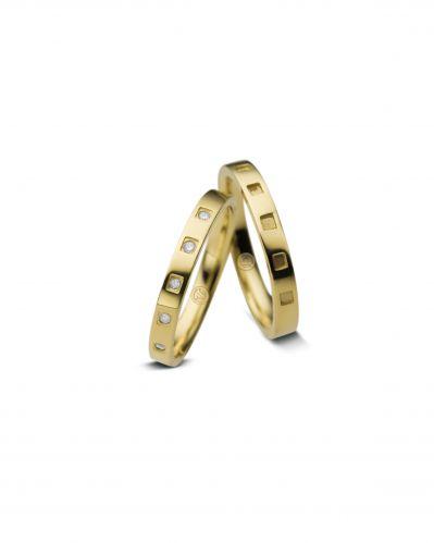 Alianças Endless, modelo feminino em ouro amarelo e ouro branco com diamantes; e masculino em ouro amarelo, na Vivara (SAC: 0800 7744999)